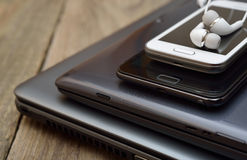 Laptop, tablet and mobile phone. On a wooden background Royalty Free Stock Images