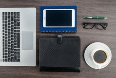 Laptop and Tablet with notebook and pen on the desk Royalty Free Stock Photo