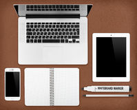 Laptop tablet, notepad and smartphone on the desk Royalty Free Stock Image