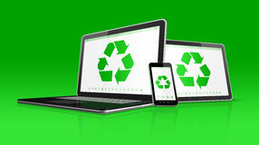 Laptop tablet PC and smartphone with a recycle symbol on screen. Royalty Free Stock Photography