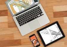 Laptop, tablet and phone on a desk. On tablet white and black blueprint and on phone and laptop with Stock Image