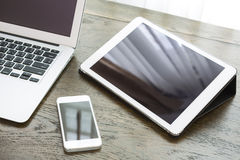 Laptop with tablet and smart phone on table. Laptop with tablet and smart phone on wood table royalty free stock photos