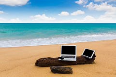 Laptop ,tablet and smartphone on the beach in summer time Stock Photography