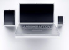 Laptop tablet and smartphone with black empty screens front view Royalty Free Stock Images