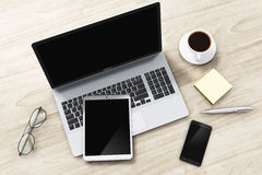 Laptop, tablet and smartphone on office table. 3D render illustration of laptop or notebook, tablet computer PC, modern black glossy touchscreen smartphone or Royalty Free Stock Image