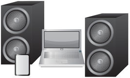 Laptop, Tablet and Speakers Royalty Free Stock Image