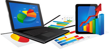 Laptop and Tablet with Statistics chart. Laptop and Tablet with with 3d graph and paper with statistic charts Royalty Free Stock Photography