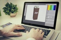 Laptop on tabletop branding design. Hands using laptop on desktop with spackaging design software Stock Image