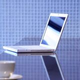 Laptop and tea cup Stock Images