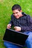 Laptop teen. Teen boy with laptop outdoors Stock Image