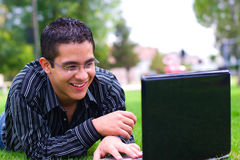 Laptop teenager. Teenager male with laptop and glasses Stock Photos