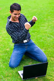 Laptop teenager. Teen student with laptop excited with achievement Stock Photo