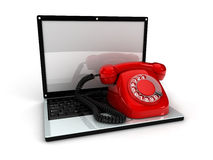 Laptop and telephone Royalty Free Stock Photography