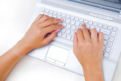 Laptop Texting. Business Lady texting on a white laptop or computer keyboard Royalty Free Stock Photo