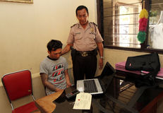 Laptop thief. Police arrest a laptop thief in the city of Solo, Central Java, Indonesia Royalty Free Stock Image
