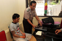 Laptop thief. Police arrest a laptop thief in the city of Solo, Central Java, Indonesia Stock Image