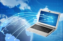 Laptop to Worldwide Connection Stock Photography