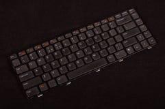 Laptop toetsenbordvervanging op de donkere achtergrond wordt geïsoleerd die Stock Foto's