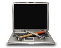 Laptop and tools Stock Photos