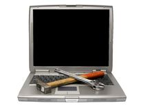 Laptop and tools Royalty Free Stock Images