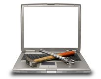 Laptop and tools Stock Photography