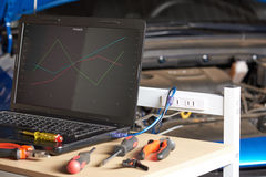 Laptop and tools for car diagnostic. Laptop and tools on table for car diagnostic. Working place of car electrician stock photography