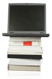 Laptop on top of books Stock Images