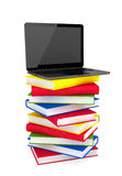 Laptop on top of stack of colorful books Royalty Free Stock Image