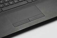 Laptop touchpad en toetsenbord stock foto