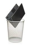 Laptop in a trash bin Stock Image