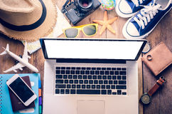 Laptop and travel accessories costumes, Tourism planning and equipment needed for the trip on wooden floor Royalty Free Stock Photos
