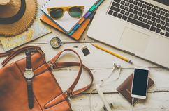 Laptop and travel accessories costumes Tourism planning Stock Image