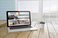 Laptop with travel agency website on screen with port background. Laptop with coffee showing travel agency website website on screen near the window. 3d Royalty Free Stock Photos