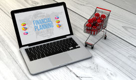 Laptop and trolley financial. Christmas sales strategy concept: Digital generated laptop with shopping cart full of christmas or gift boxes over wooden desk with Royalty Free Stock Photos