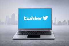 Laptop with twitter logo on the screen. JAKARTA, SEPTEMBER 02, 2015: Notebook computer with twitter logo on the screen. Twitter is an online social networking Stock Images