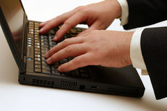 Laptop - Typing. Businessman's hands typing on the laptop keyboard. I will be very happy if you let me know when you use this image in your project Royalty Free Stock Images