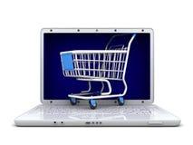 Laptop und abstrakter EShop Stockfotos