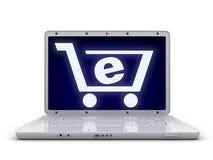 Laptop und abstrakter EShop Stockfoto