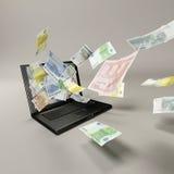 Laptop und Banknoten Stockfoto