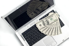 Laptop und Geld Stockfoto
