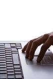 Laptop und Hand 2 Stockfotos