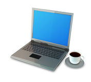 Laptop- und Kaffeetasse Stockfoto