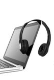 Laptop und Kopfhörer Stockbild