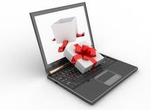 Laptop und offener Kasten des Geschenks Stockbild