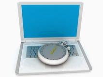 Laptop und Uhr Stockfoto