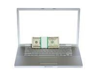 Laptop und US-Geld Stockbild