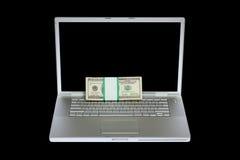 Laptop und US-Geld Stockfoto