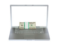 Laptop and US money Stock Image