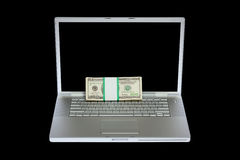 Laptop and US money Stock Photo