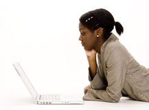 Laptop User. A young woman using a laptop on the floor Stock Images